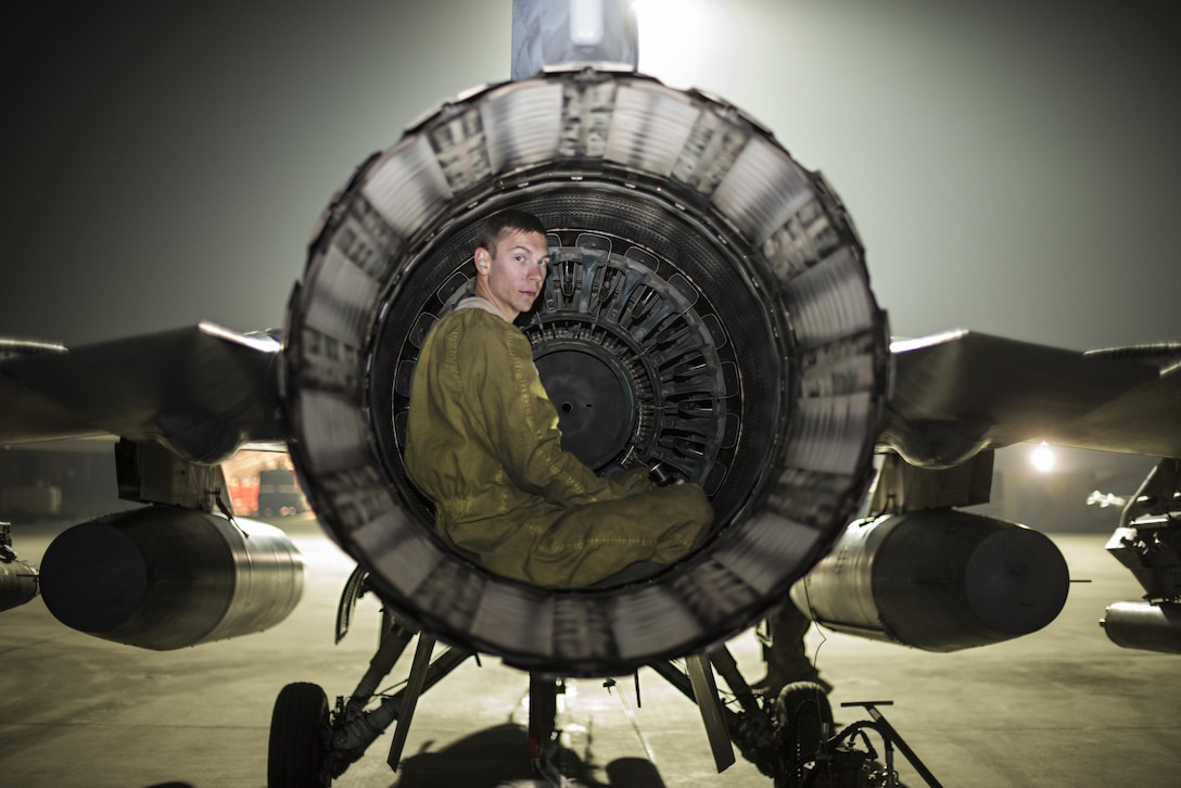 Senior Airman Daniel Lasal, a 455th Expeditionary Aircraft Maintenance Squadron crew chief, performs a post-flight inspection on an F-16 Fighting Falcon Nov. 15, 2016, at Bagram Airfield, Afghanistan. Aircraft maintainers perform six hours or more of post-flight inspections after each sortie. (U.S. Air Force photo/Staff Sgt. Katherine Spessa)