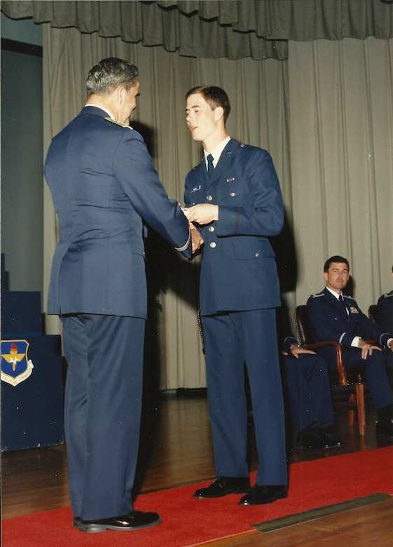 U.S. Air Force 2nd Lt. John Marks, now a Lt. Col., shakes hands with an Air Force official during his graduation from Officer Training School in 1987. Marks attended undergraduate pilot training at Columbus Air Force Base, Mississippi, shortly after his OTS graduation. (Courtesy photo provided by Mary Marks)