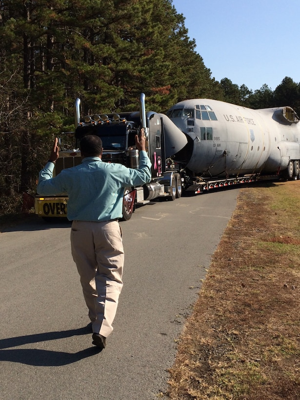 Willie Goodwin, 19th Maintenance Group Engineering and technical services specialist, marshals the final C-130E, Tail No. 9815, off Little Rock Air Force Base, Ark. Nov. 11, 2016. The aircraft retired Dec. 9, 2011, after a tornado damaged the right wing of a C-130H. Despite the E model being in good condition, its right wing was given to the C-130H which had less flying hours. (Courtesy photo by Lt. Col. Elizabeth Clay)