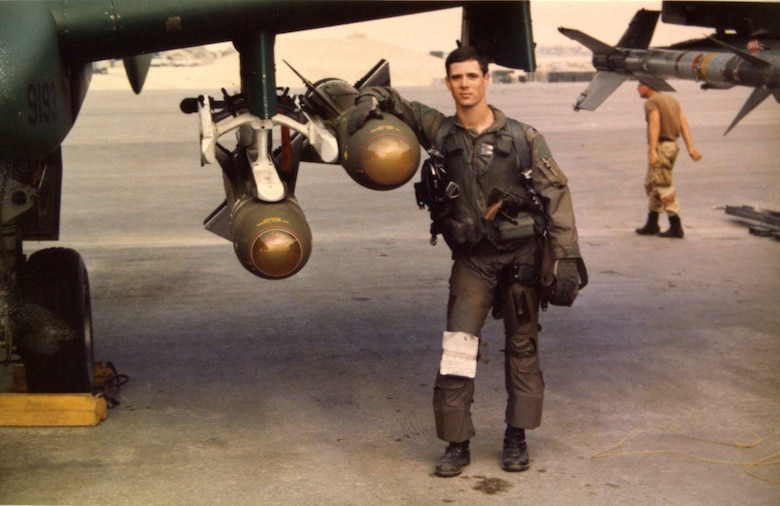 U.S. Air Force 1st Lt. John Marks poses with AGM-65 Maverick Missiles on the flightline at King Fahd Air Base, Saudi Arabia, during Desert Storm in 1991. During Desert Storm, Marks was assigned to the 76th Tactical Fighter Squadron from England Air Force Base, Louisiana. (Courtesy photo provide by Lt. Col. Marks)