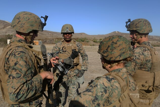 U.S. Marine Sgt. Anthony Bouquet leads his fire team in urban breaching training at Camp Pendleton, Calif., Nov. 17, 2016. Sgt. Bouquet is a combat engineer with Bravo Company, 7th Engineer Support Battalion, 1st Marine Logistics Group. The Marines with 7th ESB were put into fire teams and tasked to build explosive devices such as a hinge charge, water charge and body charge to forcefully open a locked door. (U.S. Marine Corps Photo by Lance Cpl. Joseph Sorci)