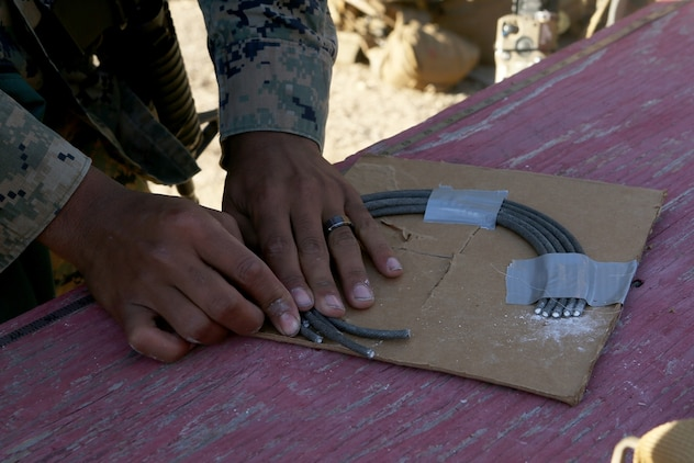 U.S. Marines with the Bravo Company, 7th Engineer Support Battalion, 1st Marine Logistics Group, build a door hinge bomb charge, designed to blow a hole around a door hinge for quick entry during urban breaching exercises at Camp Pendleton, Calif., Nov. 17, 2016. The Marines with 7th ESB were put into fire teams and tasked to build explosive devices such as a hinge charge, water charge and body charge to forcefully open a locked door. (U.S. Marine Corps photo by Lance Cpl. Joseph Sorci)