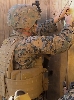 U.S. Marine Lance Cpl. Ryan Malley sets up a hinge charge in preparation for urban breaching training at Camp Pendleton, Calif., Nov. 17, 2016. The hinge charge is a small explosive designed to detonate a door hinge for easy entry to a building. Malley is a combat engineer with Bravo Company, 7th Engineer Support Battalion, 1st Marine Logistics Group. The Marines with 7th ESB were put into fire teams and tasked to build explosive devices such as a hinge charges, water charges and body charges to forcefully open a locked door. (U.S. Marine Corps Photo by Lance Cpl. Joseph Sorci)