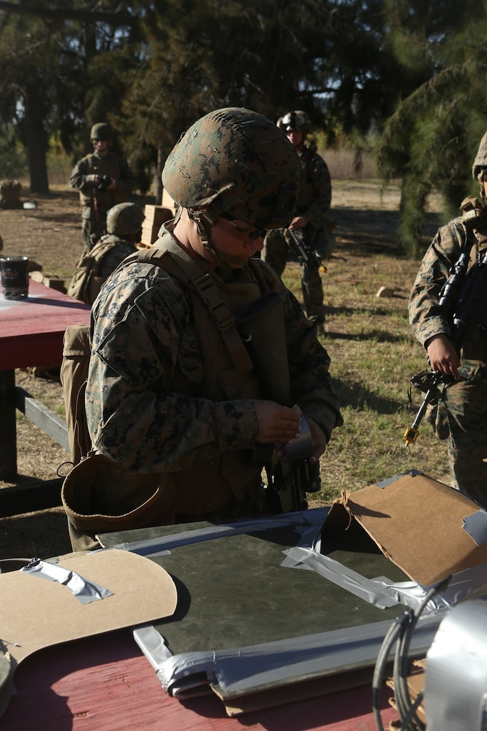U.S. Marine Lance Cpl. Heather Schneider sets up a body charge in preparation for urban breaching training at Camp Pendleton, Calif., Nov. 17, 2016. Schneider is a combat engineer with Bravo Company, 7th Engineer Support Battalion, 1st Marine Logistics Group.  The Marines with 7th ESB were put into fire teams and tasked to build explosive devices such as a hinge charges, water charges and body charges to forcefully open a locked door. (U.S. Marine Corps Photo by Lance Cpl. Joseph Sorci)