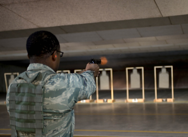 Senior Airman Tijon North, a response force leader assigned to the 28th Security Forces Squadron, fires an M9 pistol at the Combat Arms Training and Maintenance firing range at Ellsworth Air Force Base, S.D., Oct. 6, 2016. Ellsworth's CATM has trained more than 2,000 Airmen this year with more than 500 sent downrange. (U.S. Air Force photo by Airman 1st Class Donald C. Knechtel)
