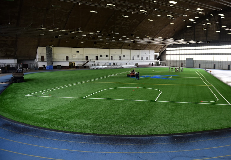 The Pride Hangar receives the final touches of its renovation at Ellsworth Air Force Base S.D., Nov. 21, 2016. The $249,000 project consisted of installation of a new Field Turf XT-65 sports field, increasing the area of the turf by 7,000 square feet, and two new batting cages. (U.S. Air Force photo by Airman 1st Class James L. Miller)
