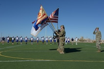 The Fort Huachuca Honor Guard presents the colors before the start of the 3rd annual Army vs. Air Force Turkey Bowl at Fort Huachuca, Ariz., Nov. 18, 2016. The Turkey Bowl is a friendly annual flag-football game between the Fort Huachuca Black Knights and the Davis-Monthan Air Force Base Mustangs. (U.S. Air Force photo by Senior Airman Betty R. Chevalier)