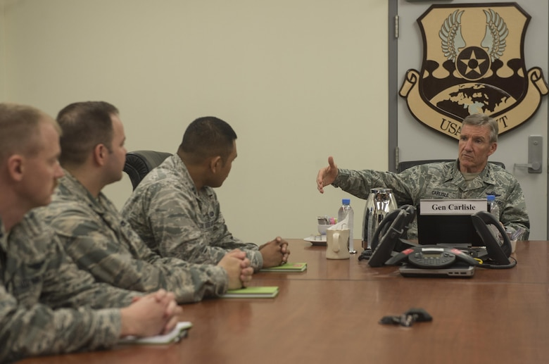 Gen. Hawk Carlisle, commander of Air Combat Command, talks with company-grade officers deployed to Al Udeid Air Base, Qatar, during a mentoring session Nov. 21, 2016. Carlisle traveled to various bases in the U.S. Air Forces Central Command to visit with Airmen and address their concerns. (U.S. Air Force photo by Staff Sgt. Matthew B. Fredericks)