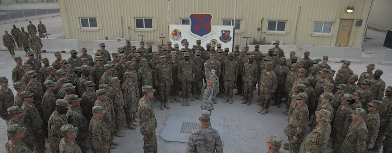 Gen. Hawk Carlisle, commander of Air Combat Command, leads 1st Expeditionary Civil Engineer Group Airmen in a chant after his visit Nov. 21, 2016 at Al Udeid Air Base, Qatar. Carlisle is visiting bases in the U.S. Central Command area of responsibility to engage with Airmen and thank them for their service. (U.S. Air Force photo by Staff Sgt. Matthew B. Fredericks)