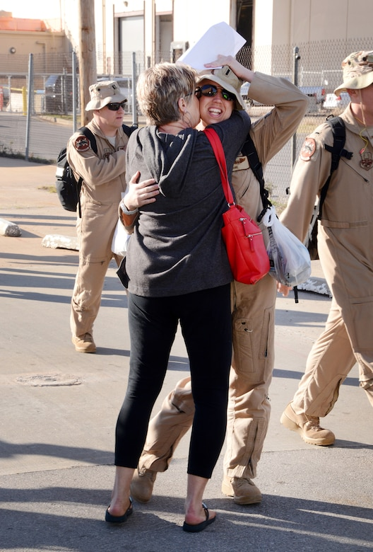 First Lt. Stephanie's mom, Grace, runs to embrace her daughter after the lieutenant's arrival from her deployment with her squadron. (Air Force photo by Kelly White)