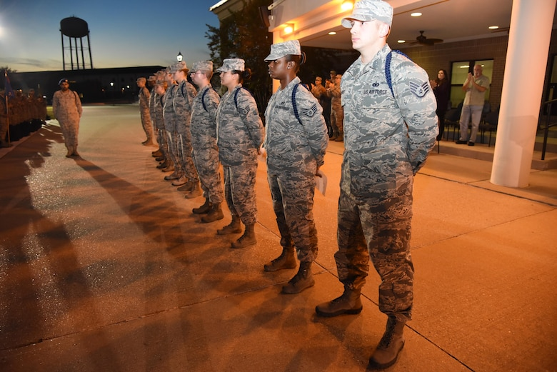Airmen stand in formation during a Military Training Leader Course graduation ceremony at Keesler Air Force Base, Miss., Nov. 18, 2016. The graduates wear a blue aiguillette to signify their role in the Air Force as a MTL. These Airmen are the first graduates to attend a revised MTL course which includes Human Behavior and the Profession of Arms Center of Excellence training. (U.S. Air Force photo by Kemberly Groue)