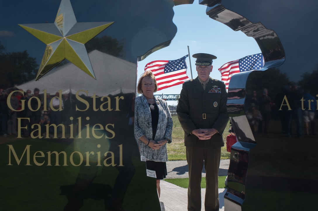 Marine Corps Gen. Joe Dunford, chairman of the Joint Chiefs of Staff, helps unveil the new Gold Star Families Memorial Monument in Fall River, Mass., Sept. 25, 2016. The memorial is a tribute to the Massachusetts families who lost loved ones in military service to the country. DoD photo by Navy Petty Officer 2nd Class Dominique A. Pineiro