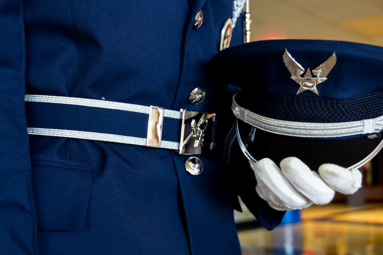 SIOUX FALLS, S.D. - A wheel cap, a blue with white border web belt, and white gloves is added to the Air Force service dress uniform as part of the 114th Fighter Wing color guard uniform. The 114th Fighter Wing color guard is organized through the Non-Commissioned Officer Academy Graduates Association where they strive to instill pride and esprit de' corps through patriotism and community involvement. (U.S. Air Guard photo by Staff Sgt. Duane Duimstra/Released)