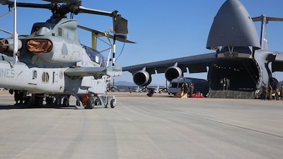 An AH-1Z Viper with Marine Light Attack Helicopter Squadron (HMLA) 267 is prepared to be transported on a C-17 Globemaster III aboard Marine Corps Air Station Miramar, Calif., Nov. 10. HMLA-267 deployed to MCAS Futenma, Okinawa, Japan, in November.