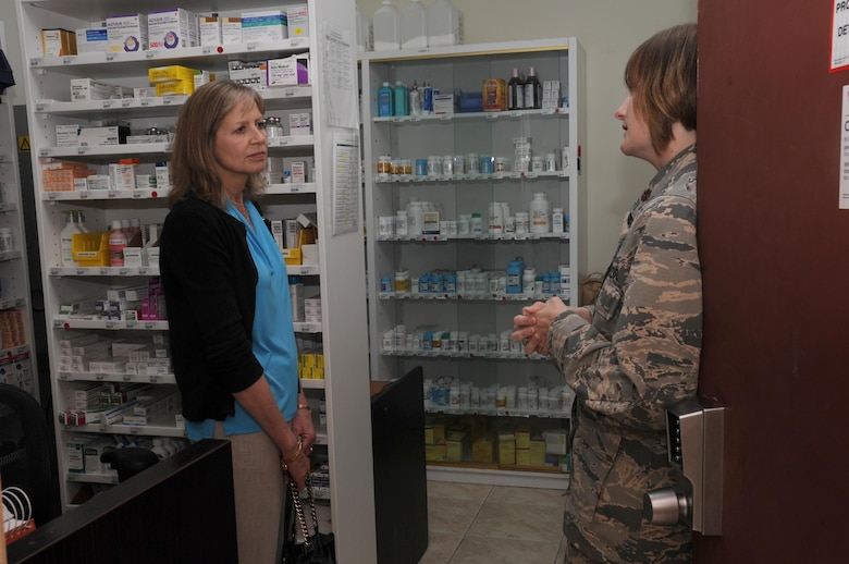 Mrs. Gillian Carlisle, wife of U.S. Air Force Gen. Hawk Carlisle, commander of Air Combat Command, visits the pharmacy at the 386th  Expeditionary Medical Group clinic at an undisclosed location in Southwest Asia Nov. 23, 2016. The clinic's services include general medicine, physical therapy sessions, dental care and mental health. (U.S. Air Force photo/Tech. Sgt. Kenneth McCann)