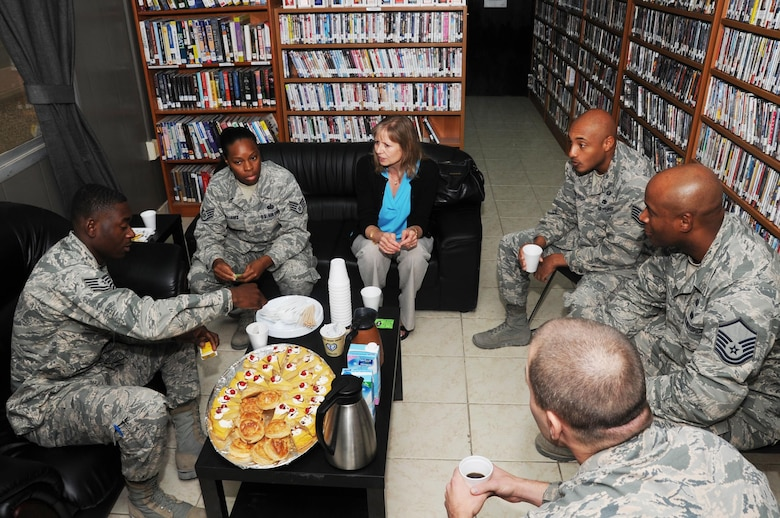 Mrs. Gillian Carlisle, wife of U.S. Air Force Gen. Hawk Carlisle, commander of Air Combat Command, speaks with 386th Expeditionary Force Support Airmen at The Wired morale facility at an undisclosed location in Southwest Asia Nov. 23, 2016. This tour gave Mrs. Carlisle an opportunity to visit various morale, recreation and welfare facilities 386th Air Expeditionary Wing Airmen use on a daily basis. (U.S. Air Force photo/Tech. Sgt. Kenneth McCann)