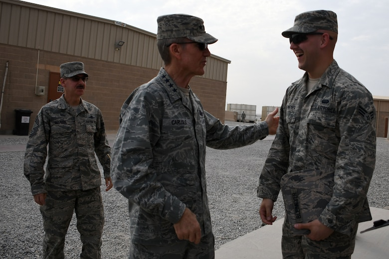 U.S. Air Force Gen. Hawk Carlisle, commander of Air Combat Command, talks with an Airman after his all call Nov. 23, 2016 at an undisclosed location in Southwest Asia. Carlisle stressed to the 386th Air Expeditionary Wing's Airmen that they were the Air Force's most valuable asset. (U.S. Air Force photo/Senior Airman Andrew Park)