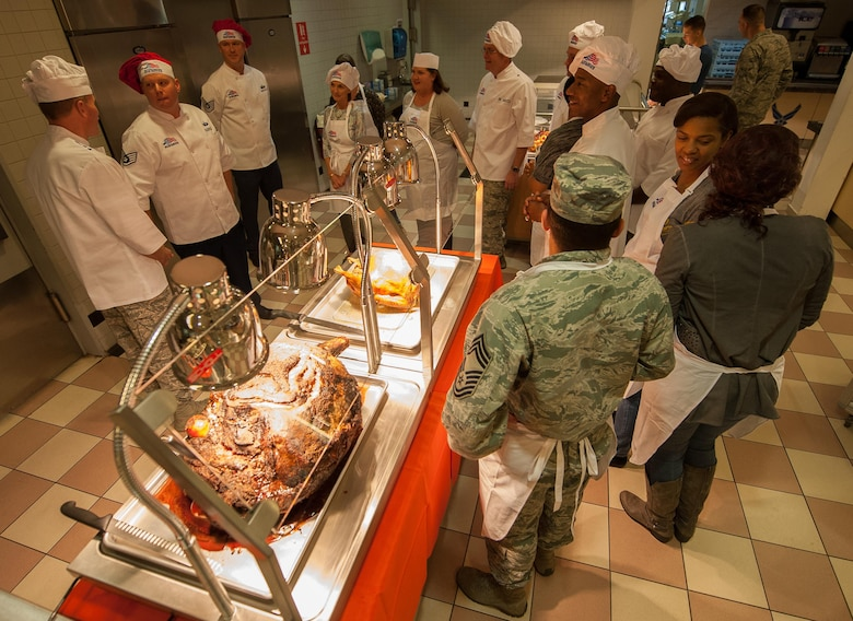 Ramstein leadership meet with the Rheinland Inn Dining Facility staff before Airmen eat during a Thanksgiving meal at Ramstein Air Base, Germany, Nov. 24, 2016. Every year at Ramstein, leadership across the Kaiserslautern Military Community visits the base's dining facility to cook food and meet Airmen during Thanksgiving. In the U.S., the modern Thanksgiving holiday tradition can trace its origins back to 1621 in the heart of a newly-founded city called Plymouth in present-day Massachusetts. However, the first nationwide Thanksgiving proclamation was made by the first president of the U.S., George Washington, in 1789. Since then, the holiday has been celebrated by an entire nation to recount the blessings of the year. (U.S. Air Force photo by Airman 1st Class Lane T. Plummer)