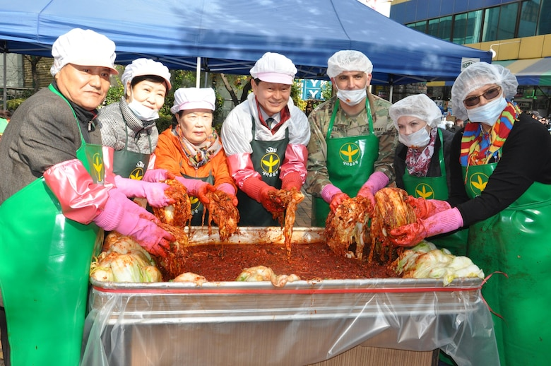 US Army Corps of Engineers Far East District Deputy Commander, Lt. Col. Richard Collins (third from right), Hope Bales, wife of FED Commander Col. Stephen Bales (far right) and volunteers from the Far East District joined members of the Seoul Jung-gu Saemaul Women's Club to make kimchi for the area's needy and elderly families Nov. 18.
