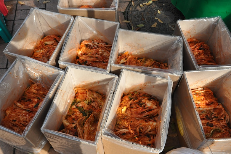 Participants in this annual event transformed more than 2,500 heads of cabbage into 500 boxes of kimchi.