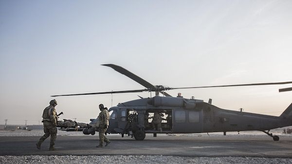 Senior Airman Tammer Barkouki, 83rd Expeditionary Rescue Squadron pararescuman, and Maj. David Depiazza, 83rd ERQS combat rescue officer, carry a patient by litter onto an HH-60 Pave Hawk helicopter for evacuation during a mass casualty exercise held Nov. 17, 2016 at Bagram Airfield, Afghanistan. Training scenarios are based on real-world situations that have been encountered in past operations. (U.S. Air Force photo by Staff Sgt. Katherine Spessa)
