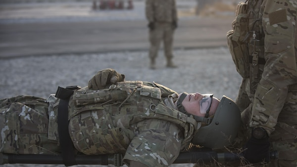 Tech. Sgt. Amity Quinones, 83rd Expeditionary Rescue Squadron, acts as an injured servicemember during a mass casualty exercise held Nov. 17, 2016 at Bagram Airfield, Afghanistan. The exercise provided realistic training on how to respond to an IED blast resulting in multiple injuries. (U.S. Air Force photo by Staff Sgt. Katherine Spessa)