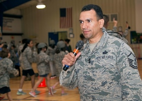 "Air Force Master Sgt. Joe Ugarte, 802nd Force Support Squadron Military Family Readiness Center readiness noncommissioned officer, gives instructions during Operation FLAGS, which stands for Families Learning About Global Support, at Randolph Elementary School at Joint Base San Antonio-Randolph, Texas, May 18, 2016. About 300 third-, fourth- and fifth-graders from Randolph Elementary School accomplished a special ""mission"" where they experienced what it's like for their active-duty parents to leave for a deployment. Courtesy photo"