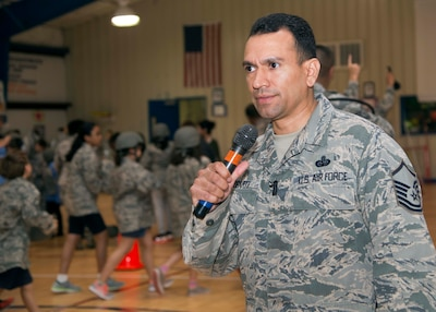 """Air Force Master Sgt. Joe Ugarte, 802nd Force Support Squadron Military Family Readiness Center readiness noncommissioned officer, gives instructions during Operation FLAGS, which stands for Families Learning About Global Support, at Randolph Elementary School at Joint Base San Antonio-Randolph, Texas, May 18, 2016. About 300 third-, fourth- and fifth-graders from Randolph Elementary School accomplished a special """"mission"""" where they experienced what it's like for their active-duty parents to leave for a deployment. Courtesy photo"""