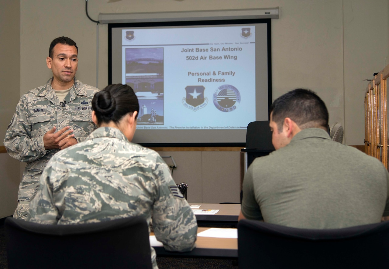Air Force Master Sgt. Joe Ugarte, 802nd Force Support Squadron Military Family Readiness Center readiness noncommissioned officer, briefs service members and their families who are readying themselves for an upcoming deployment at Joint Base San Antonio-Randolph, Texas, May 24, 2016. Courtesy photo