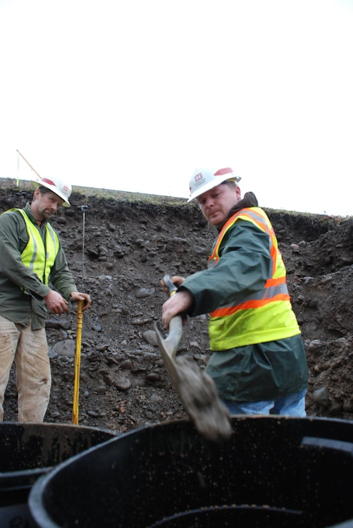 Brandon Betz (right), Savannah District, U.S. Army Corps of Engineers geotechnical engineer, and Joseph Manning, Savannah Cadre geologist, dig a test pit at Hills Creek Dam, Ore., Nov. 15.