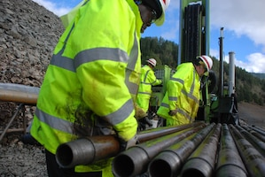 Savannah District employees remove core samples from Hills Creek Dam.