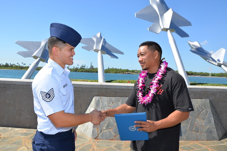 Tech. Sgt. Michael Shinohara, an Air Force Reserve recruiter based out of Joint Base Pearl Harbor-Hickam, and a Yigo, Guam native, congratulates Adrian Faustino after he signed his oath of enlistment at the Missing Man Formation, JBPH-H, Hawaii, Nov. 10, 2016. Faustino, who plans to join the 48th Aerial Port Squadron as an Air Transportation specialist, was referred by a reservist who used the Get 1 Now app. Located on Oahu and a component of the Air Force Reserve, the 48th APS provides expertise in all areas of air terminal operations to include aircraft loading, cargo processing and inspecting, passenger services, aircraft fleet services and aerial port command and control. The 48th APS supports the 624th Regional Support Group's mission to deliver mission essential capability through combat readiness, quality management and peacetime deployments in the Pacific area of responsibility. (U.S. Air Force photo by Master Sgt. Theanne Herrmann)