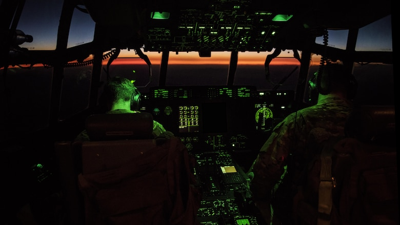 Capts. Nick Bonner and David Tart, 774th Expeditionary Airlift Squadron C-130J Hercules pilots, fly a C-130 to Farah Airfield, Afghanistan Nov. 10, 2016. The 774th EAS uses the unique versatility of the C-130 to supplement tactical airlift capabilities for units in and out of austere locations under atypical conditions. Edits were made to this image for security purposes. (U.S. Air Force illustration by Staff Sgt. Katherine Spessa)