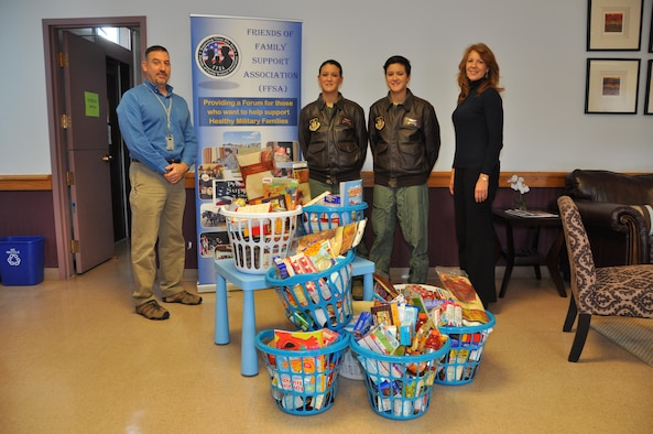 Senior Airman Raquel Densmore (pictured center right), 328th Airlift Squadron, delivers to the Niagara Falls Air Reserve Station 18 donated holiday baskets filled with everything needed for a Thanksgiving dinner November 21, 2016. Densmore's civilian employer, T.Y. Lin International, donated the baskets.  Also pictured are Joel Smith, 914 AW Airman and Family Readiness, Senior Airman Rochelle Densmore, 328 AS, and Holly Curcione, Friends of Family Support Association.  (U.S. Air Force photo by Master Sgt. Kevin Nichols)