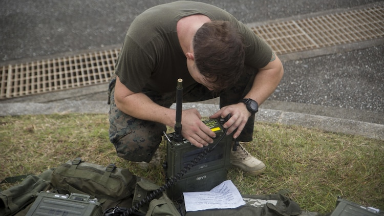 A Marine from 3d Reconnaissance Battalion, 3d Marine Division, III Marine Expeditionary Force, sets up a radio frequency for a communications check on Camp Schwab, Okinawa, Japan, Nov. 23, 2016, during their annual Warrior Challenge. The Warrior Challenge is an event which honors fallen Marines in the battalion and consists of nine stations to challenge the Marines mentally and physically. (U.S. Marine Corps photo by Lance Cpl. Andrew Neumann/Released)