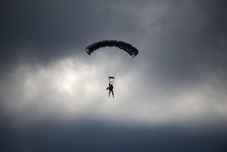 A U.S. Air Force Airman from the 320th Special Tactics Squadron parachutes through the sky after performing a long-range jump from a C-17 Globemaster III over the Pacific Ocean Nov. 22, 2016, off the western coast of Okinawa, Japan. Special Tactics team Airmen are organized, trained and equipped to conduct special operations core tasks during high-risk combat operations. (U.S. Air Force photo by Senior Airman Omari Bernard/Released)