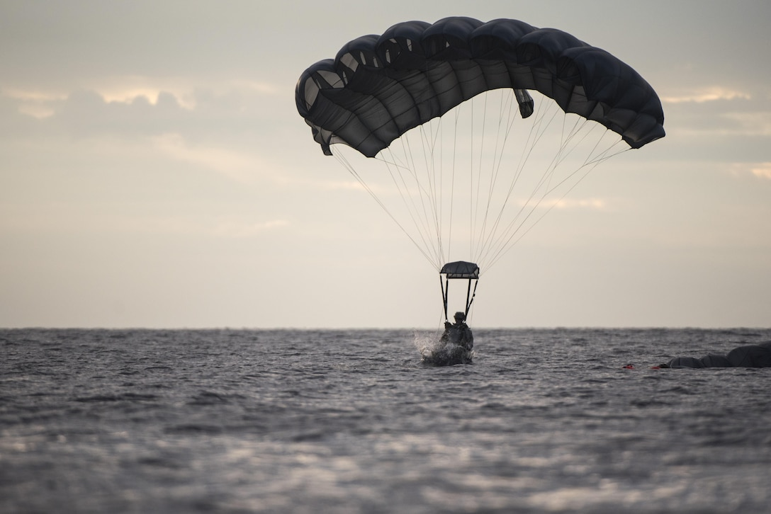 A U.S. Air Force Airman from the 320th Special Tactics Squadron lands in the water after performing a long-range jump from a C-17 Globemaster III into the Pacific Ocean Nov. 22, 2016. The 320th STS Airmen are trained to operate in harsh environments and under adverse conditions to complete their objectives. (U.S. Air Force photo by Senior Airman Omari Bernard/Released)