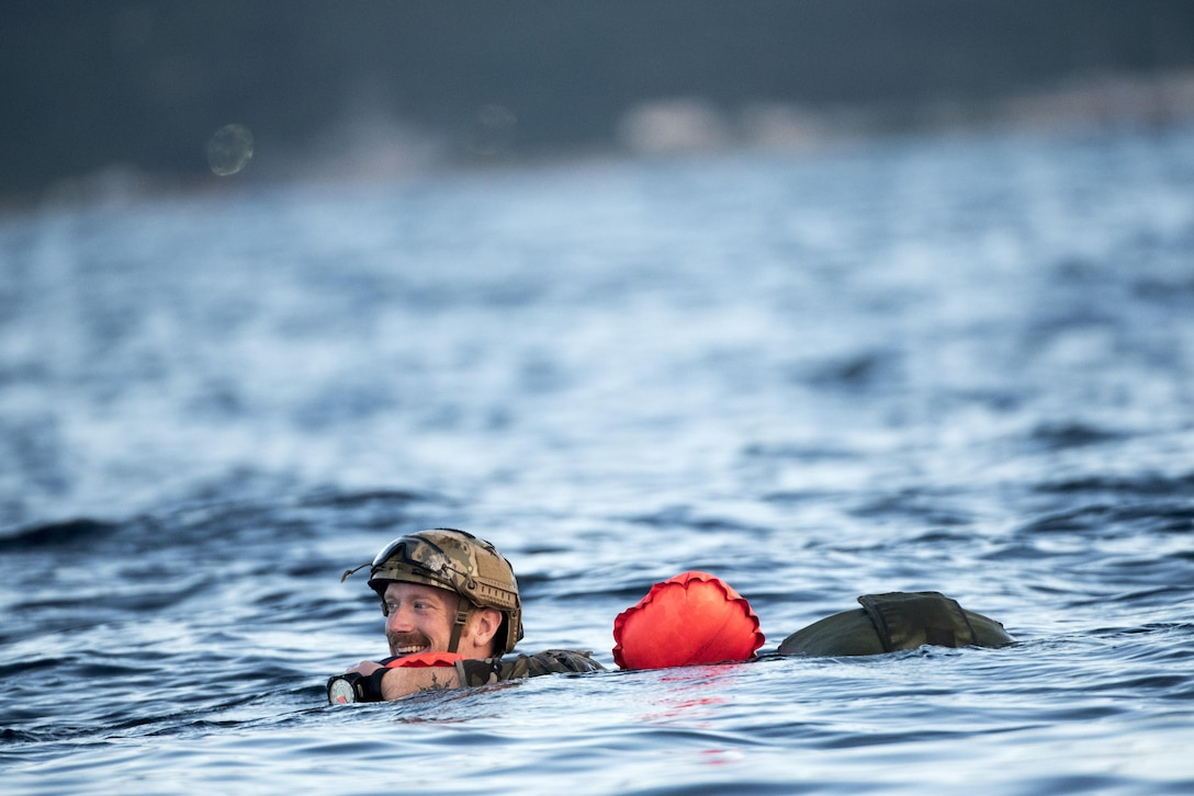 A U.S. Air Force Airman from the 320th Special Tactics Squadron swims to a vessel after performing a long-range jump from a C-17 Globemaster III into the Pacific Ocean Nov. 22, 2016. The 320th STS has combat controllers, pararescuemen and special operations weather teams who go anywhere and set up forward operating locations and impromptu runways. (U.S. Air Force photo by Senior Airman Omari Bernard/Released)