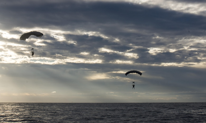 U.S. Air Force Airmen from the 320th Special Tactics Squadron at Kadena Air Base, Japan, parachute into the Pacific Ocean at dawn Nov. 22, 2016, off the western coast Okinawa, Japan. The 320th STS Airmen train to operate in adverse conditions at sea or overland to accomplish their mission. (U.S. Air Force photo by Senior Airman Omari Bernard/Released)
