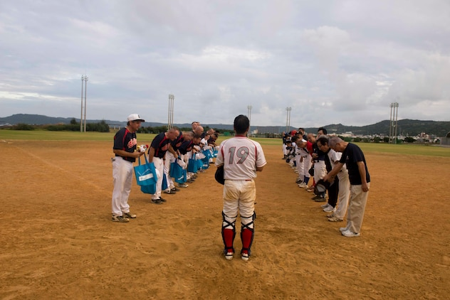 Members of the U.S. Consulate Allstars and Okinawa Prefectural Government Baseball Teams bow to each other after a baseball game Nov. 19, 2016, at a baseball field in Naha, Japan. The Allstars play games against teams on Okinawa to make friends and foster partnerships in the local community. (U.S. Air Force photo by Senior Airman Omari Bernard/Released)xxx