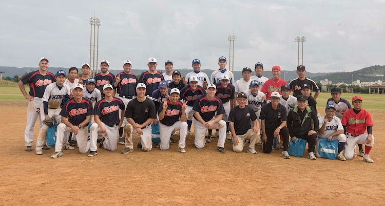 The U.S. Consulate Allstars and Okinawan Prefectural Government competitors take a group photo commemorating their game together Nov. 19, 2016 at a baseball field in Naha, Japan. The Allstars are scheduled to continue playing more baseball games throughout the rest of the year and into the summer of 2017 spreading diplomacy and building partnerships through baseball. (U.S. Air Force photo by Senior Airman Omari Bernard/Released)