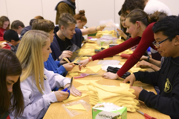 High school students craft Christmas gifts for children as part of Operation Christmas Child at Yokota Air Base, Japan, Nov. 2, 2016. Gifts sent through OCC travel to disadvantaged children throughout the world and are a popular way to give back during the holiday season. (U.S. Air Force photo by Airman 1st Class Elizabeth Baker/Released)