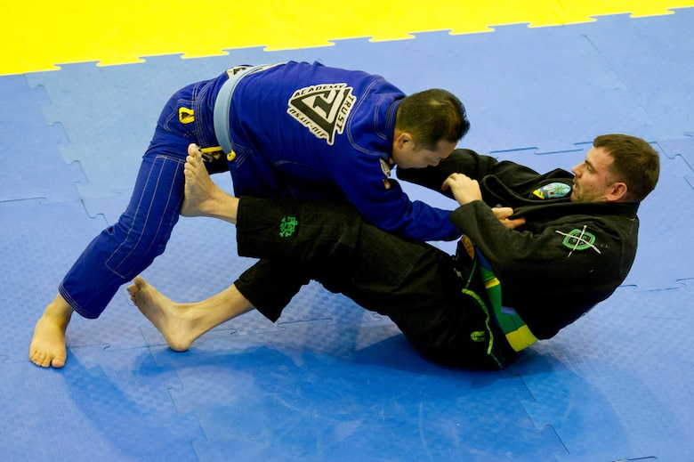 U.S. Air Force Master Sgt. Thomas Matzke, right, 607th Air Support Operations Group tactical air control party, defends against Kim San during a senior open weight class blue belt Jiu-Jitsu match during the Dumau Jiu-Jitsu Korea Grand Prix 2016 in Seoul, Republic of Korea, Nov. 27, 2016. Matzke was one of four Airmen from Osan to compete in the jiu-jitsu tournament. (U.S. Air Force photo by Staff Sgt. Jonathan Steffen)