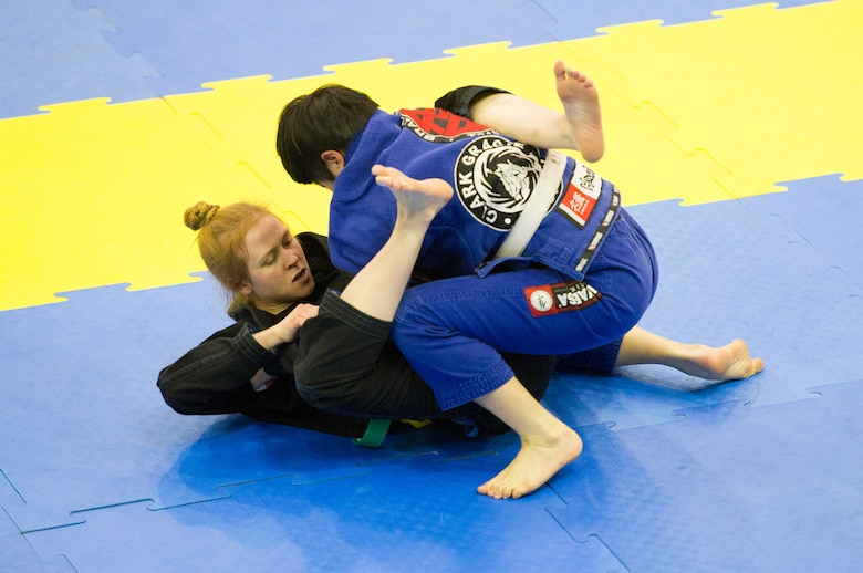 U.S. Air Force Senior Airman Kate West, 51st Medical Operations Squadron medical technician, pulls guard against Eunju Shin during a feather-weight white belt Jiu-Jitsu match during the Dumau Jiu-Jitsu Korea Grand Prix 2016 in Seoul, Republic of Korea, Nov. 27, 2016. This was West's first tournament after training for the last ten months at Osan. (U.S. Air Force photo by Staff Sgt. Jonathan Steffen)