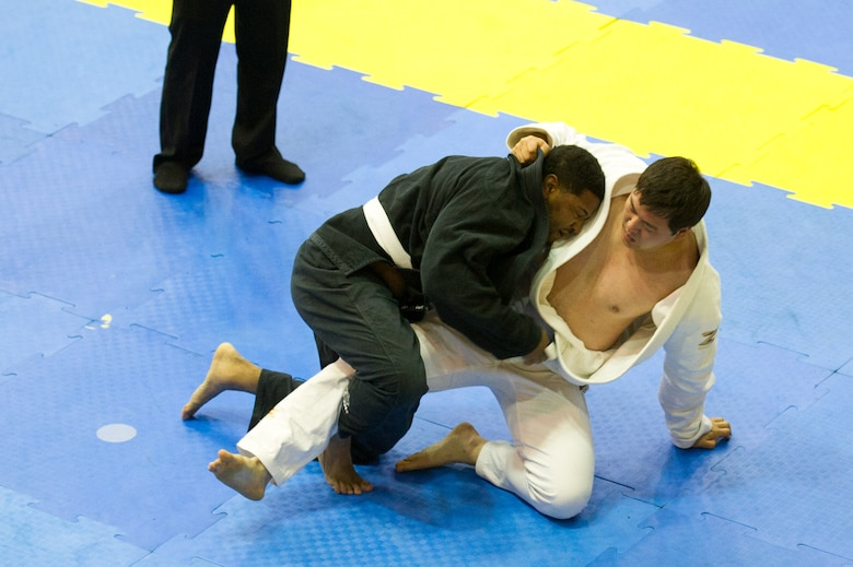 U.S. Air Force Staff Sgt. Brandon Davis, 51st Fighter Wing chaplain assistant, takes down Nam-Hyun Cho during a master ultra-heavy weight white belt Jiu-Jitsu match during the Dumau Jiu-Jitsu Korea Grand Prix 2016 in Seoul, Republic of Korea, Nov. 27, 2016. Davis won the master ultra-heavy white belt class and also won master open weight white belt class. (U.S. Air Force photo by Staff Sgt. Jonathan Steffen)