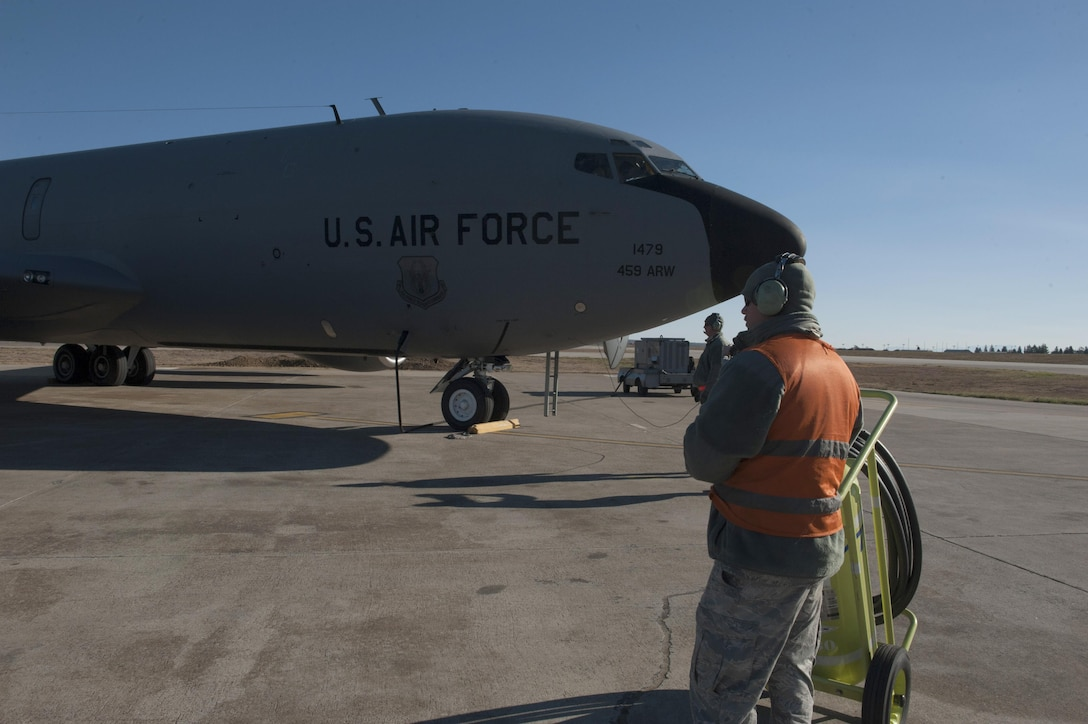 U.S. Air Force Staff Sgt. Brian (front) and Staff Sgt. Houston, 447th Expeditionary Aircraft Maintenance Squadron crew chiefs, perform initial preflight checks on a KC-135 Stratotanker Nov. 2, 2016, at Incirlik Air Base, Turkey.  Preflight checks allow for air and ground crews to ensure there are no issues with the aircraft before flight. (U.S. Air Force photo by Staff Sgt. Jack Sanders)