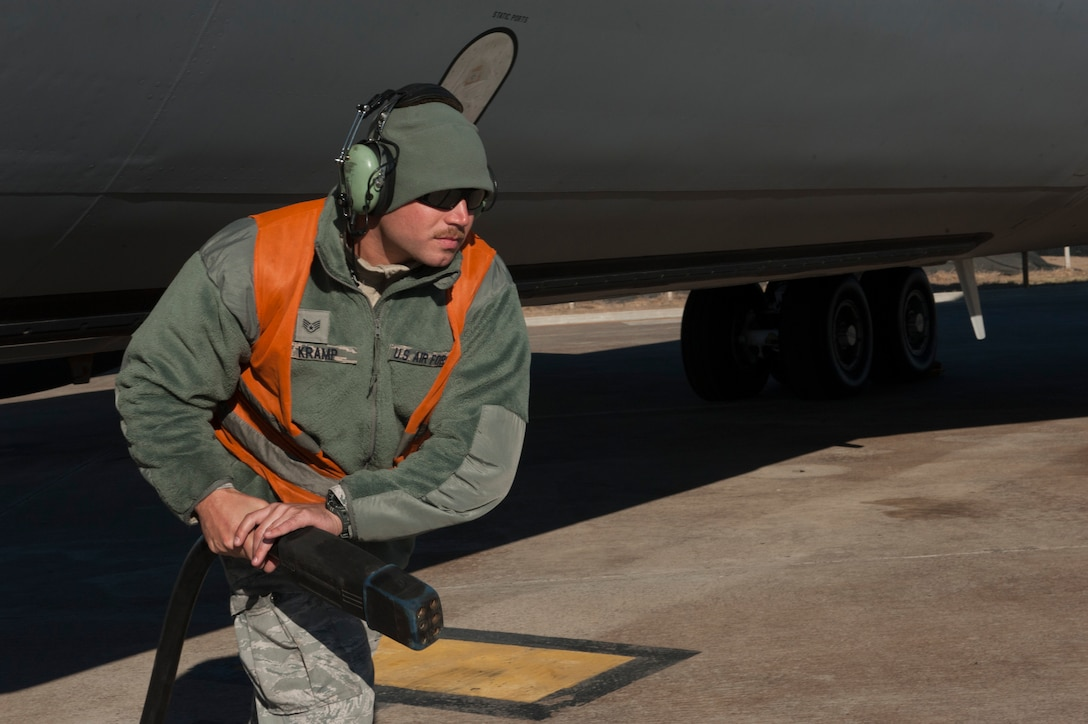 U.S. Air Force Staff Sgt. Brian, 447th Expeditionary Aircraft Maintenance Squadron crew chief, runs a power line from a KC-135 Stratotanker to aerospace ground support equipment (AGE) Nov. 2, 2016, at Incirlik Air Base, Turkey. Ground crews utilize AGE while performing preflight checks. (U.S. Air Force photo by Staff Sgt. Jack Sanders)