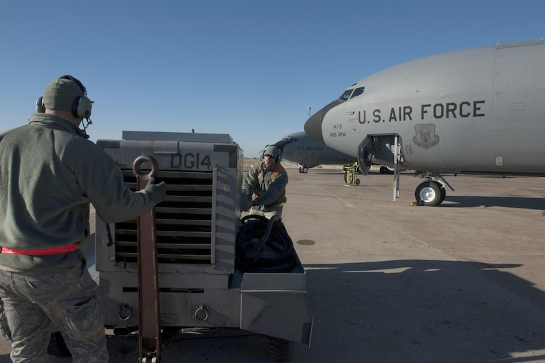 U.S. Air Force Staff Sgt. Houston (left) and Staff Sgt. Brian, 447th Expeditionary Aircraft Maintenance Squadron crew chiefs, push aerospace ground support equipment away from a KC-135 Stratotanker Nov. 2, 2016, at Incirlik Air Base, Turkey. The Stratotanker is responsible for primary aerial refueling capabilities for the U.S. Air Force. (U.S. Air Force photo by Staff Sgt. Jack Sanders)