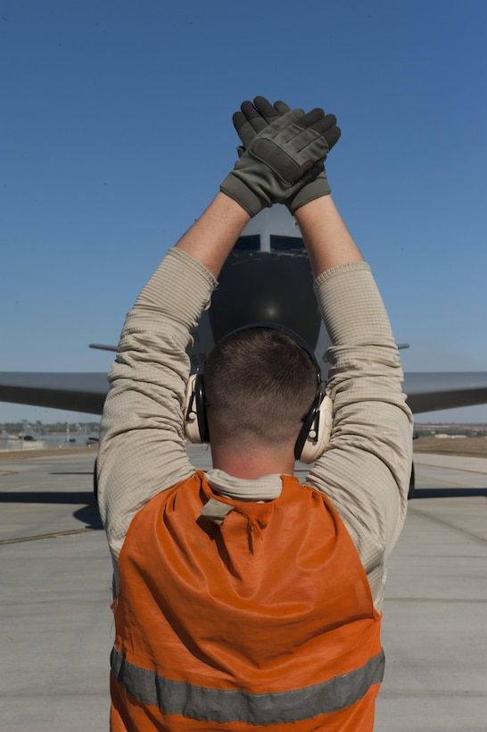 U.S. Air Force Airman 1st Class Nathaniel, 447th Expeditionary Aircraft Maintenance Squadron crew chief, marshals a KC-135 Stratotanker Nov. 2, 2016, at Incirlik Air Base, Turkey. Stratotankers provide a critical role in Operation INHERENT RESOLVE by refueling coalition forces aircraft. (U.S. Air Force photo by Staff Sgt. Jack Sanders)