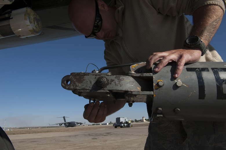 U.S. Air Force  Staff Sgt. Brian, 447th Expeditionary Aircraft Maintenance Squadron crew chief, unhooks a tow bar from the front of a KC-135 Stratotanker Nov. 11, 2016, at Incirlik Air Base, Turkey. The KC-135 Stratotanker has provided core U.S. Air Force aerial refueling capability for more than 50 years. (U.S. Air Force photo by Staff Sgt. Jack Sanders)